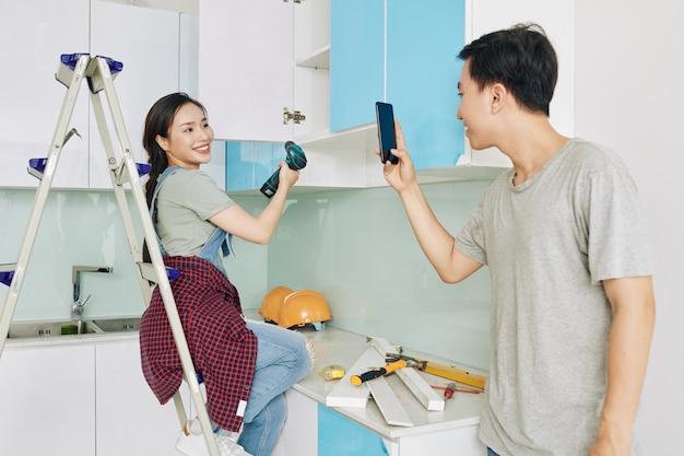 Couple filming diy renovation video