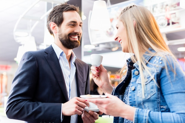 Couple flirting at date drinking coffee in cafe