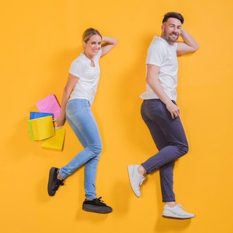 Couple flying with shopping bags