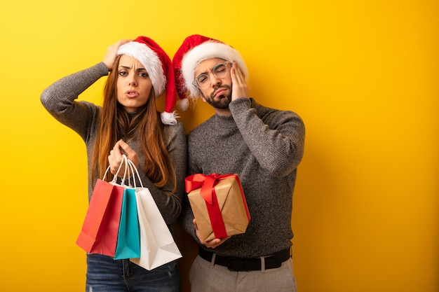 Couple or friends holding gifts and shopping bags tired and very sleepy