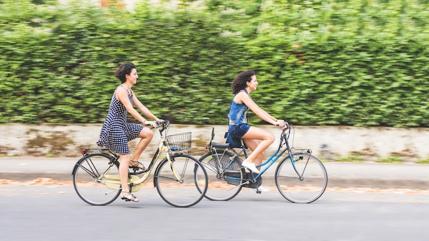 A couple of friends with bikes, motion blur.