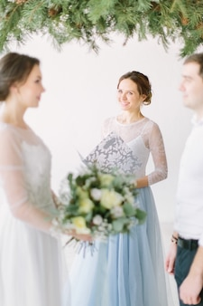 Couple getting married at an indoor wedding ceremony