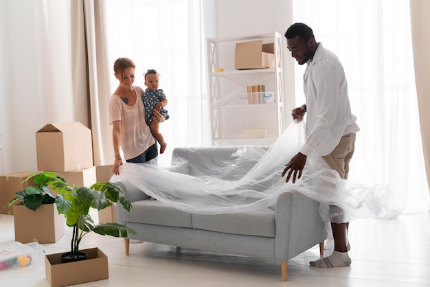 Couple getting ready to move with their daughter