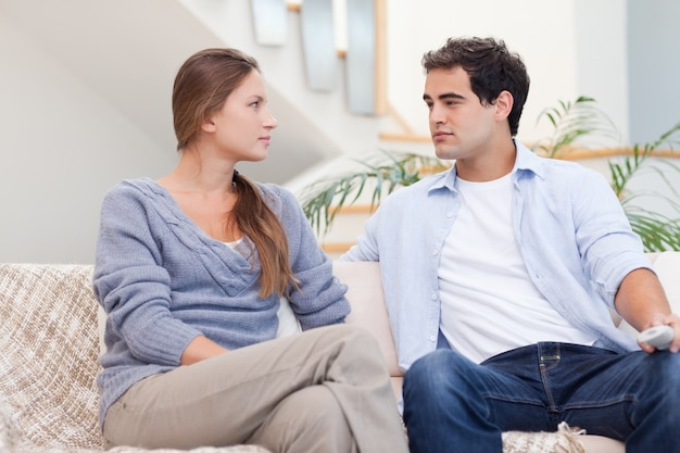 Couple having an argument while watching tv