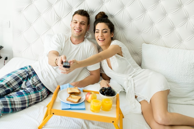 Couple having a breakfast in bed