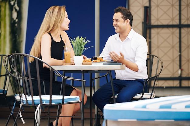Couple having breakfast in outdoor cafe