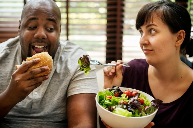 Couple having fast food on the couch