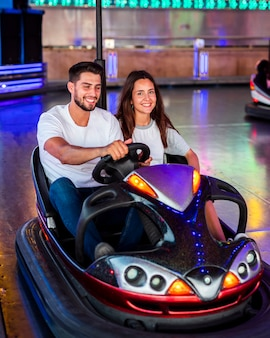 Couple having fun in bumper cars
