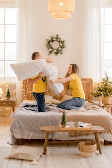 Couple having fun at home  in christmas decorations