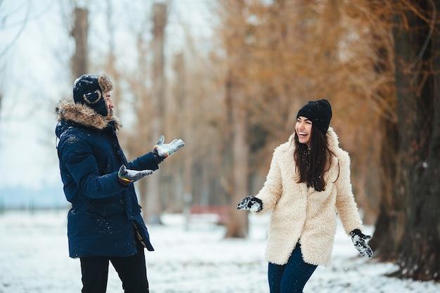 Couple having fun in the snow