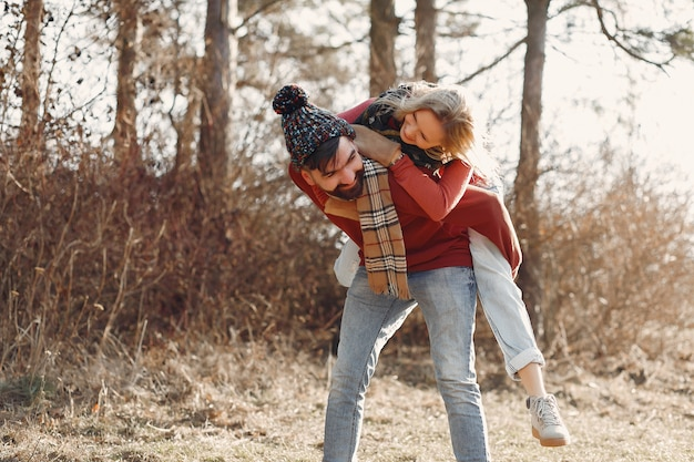 Couple having fun in a spring forest