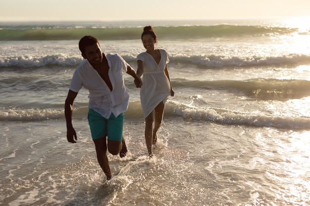 Couple having fun together on the beach