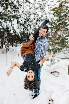 Couple having fun in winter forest