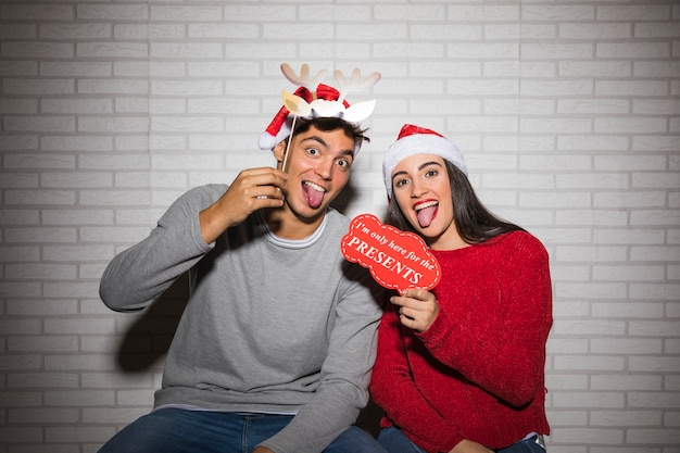Couple having fun with christmas decorations