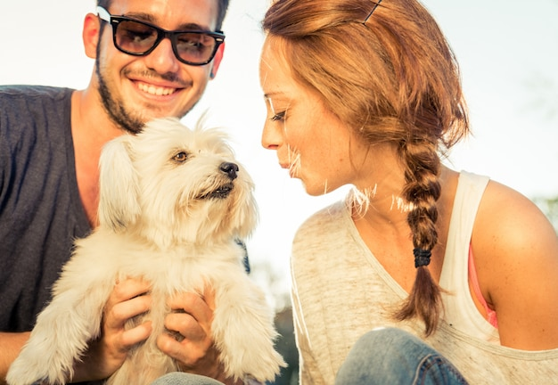 Couple having fun with their dog