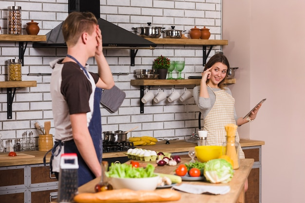 Couple having good time together in kitchen