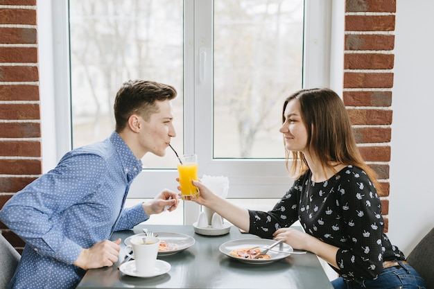 Couple having an orange juice in a restaurant