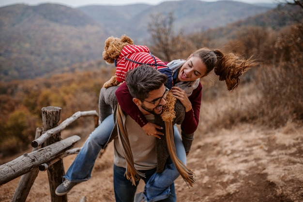 Couple having piggyback in nature