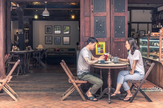 Couple having their breakfast and coffee at a cafe in luang prabang, laos
