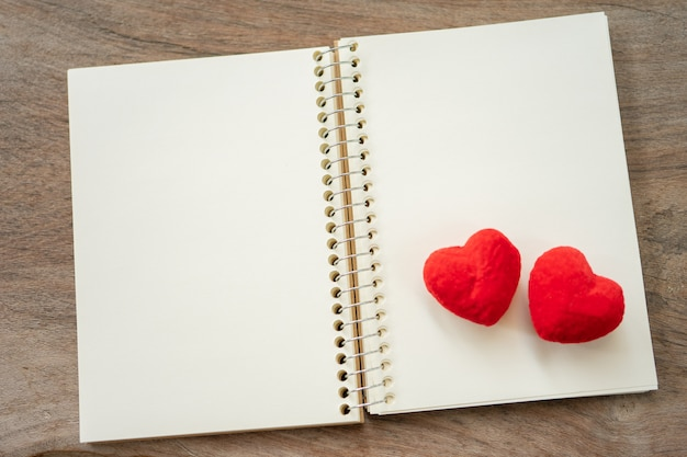 Couple heart shaped on notebook. valentine day reminder concept