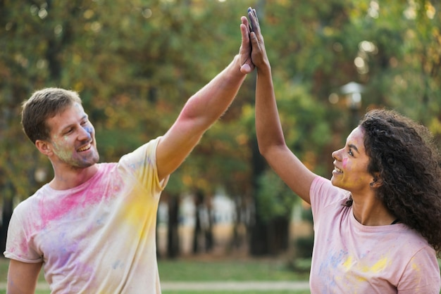 Couple high-fiving each other at holi