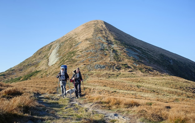Couple hikers in the carpathians mountains with backpack