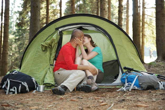 Couple of hikers rest in tent