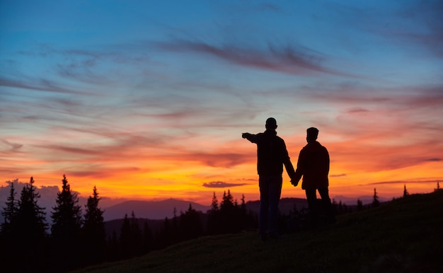 Couple hiking in the mountains together