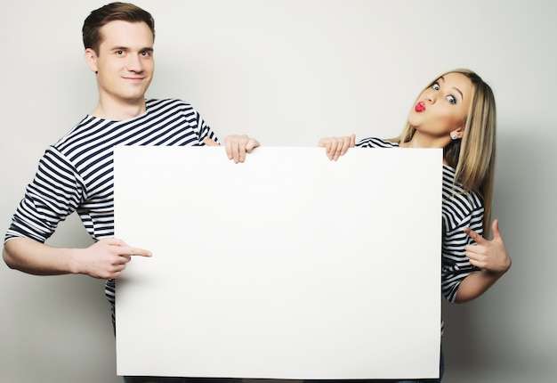 Couple holding a banner