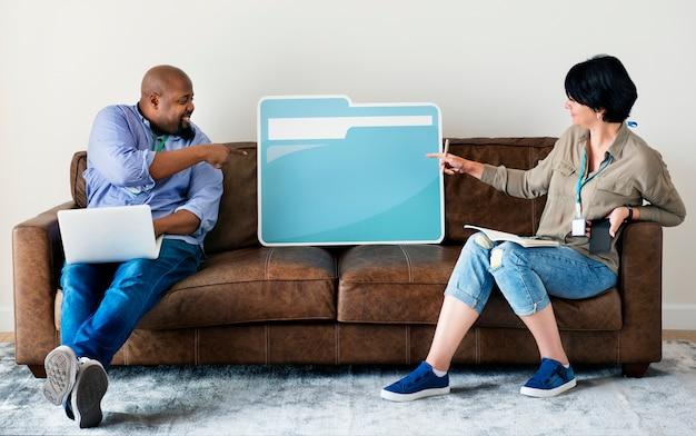 Couple holding folder icon
