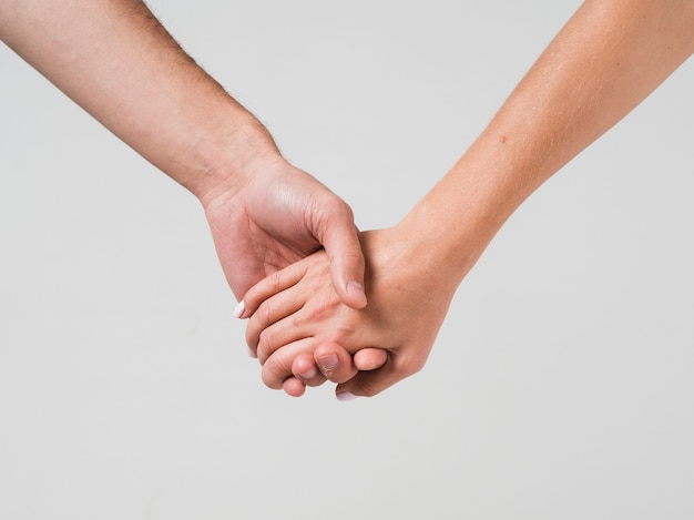 Couple holding hands for valentines day