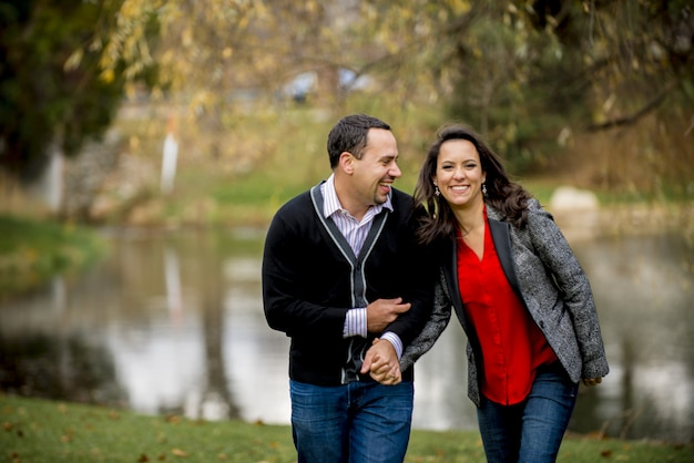 Couple holding hands while laughing