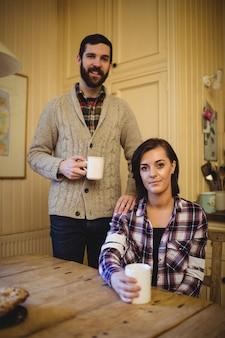 Couple holding mug of coffee