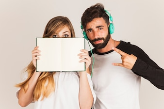 Couple holding open book