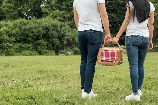 Couple holding a picnic basket