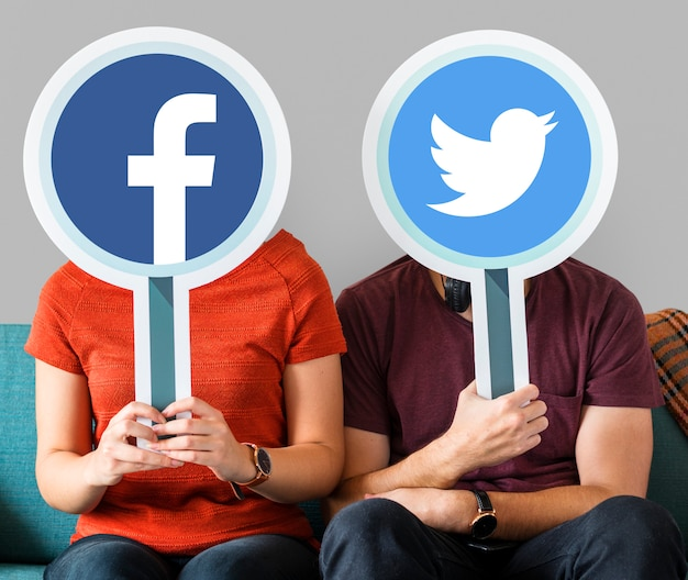 Couple holding social media icons