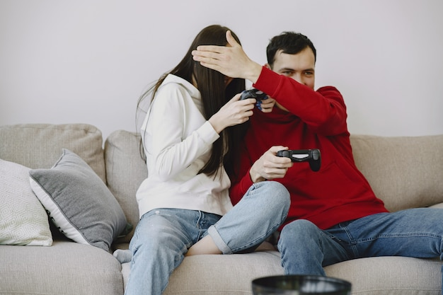 Couple at home playing video games