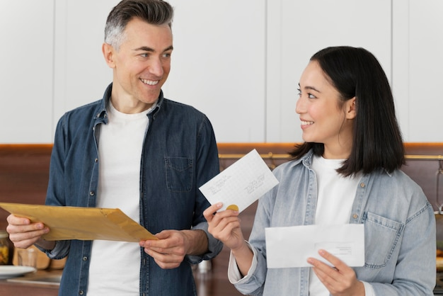 Couple at home reading mail
