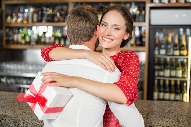 A couple hugging in a bar