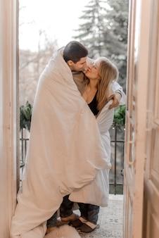 Couple hugging in bedroom