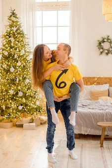 Couple hugging at home  in christmas decorations