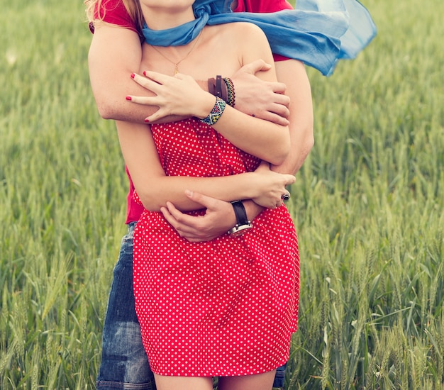 Couple hugging in a meadow