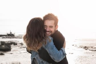 Couple hugging on seashore