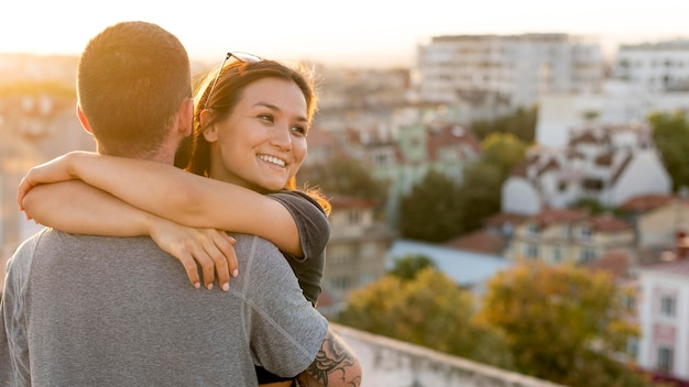 Couple hugging outdoors with copy space