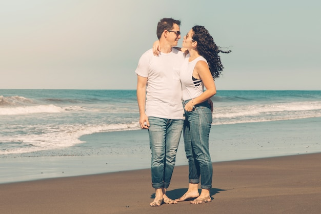 Couple hugging on sandy beach