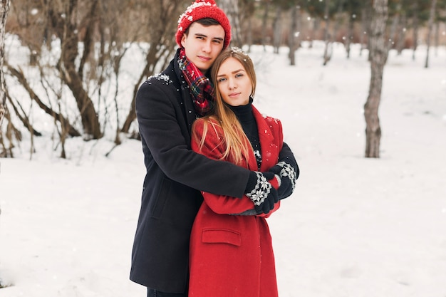 Couple hugging on a snowy day