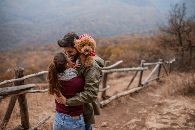 Couple hugging while standing outdoors.