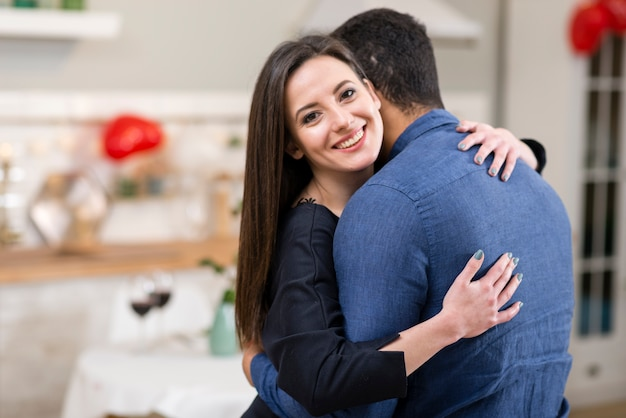 Couple hugging with copy space