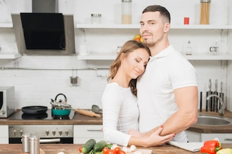 Couple in love cooking together