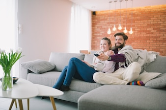 Couple in plaid watching TV